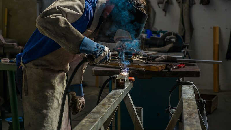 welder wearing an apron