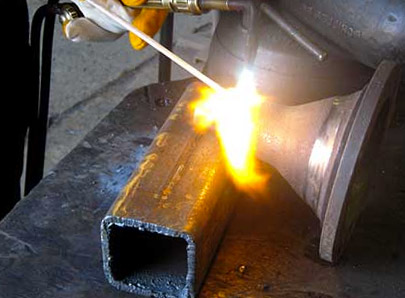 Agriculture combine part being rebuilt using cast iron brazing process with machining to the right specification.