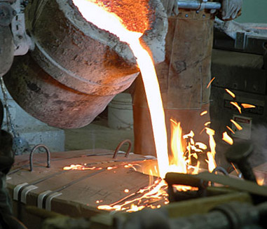 The Pouring of Molten Bronze into Sculpture Mold